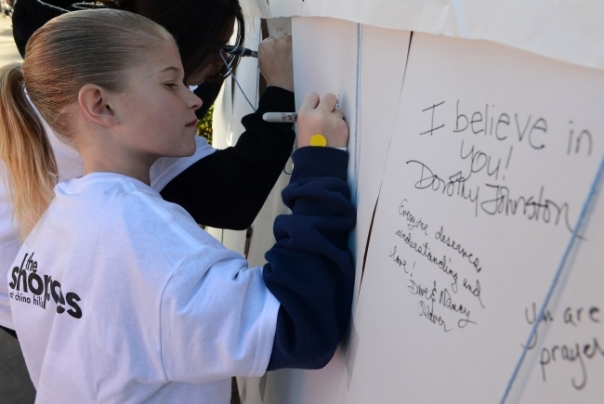 Jillian Endricks, 11, of Chino Hills, writes a message to victims of human trafficking on a message board before the annual Walk Against Human Trafficking Sunday at The Shoppes in Chino Hills. (Rachel Luna/Staff Photographer)