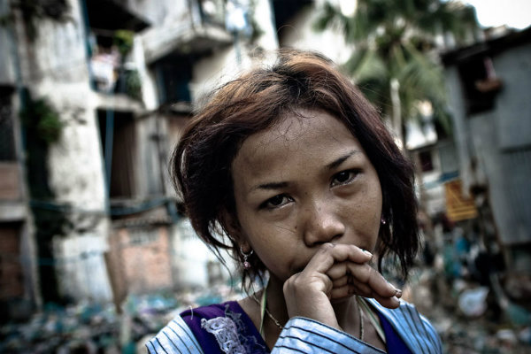A young woman in a Phnom Penh slum. Investigators later found her mother was pimping the drug-addicted girl nightly to upwards of 10 Cambodian men. (Tim Matsui)Read more: http://www.care2.com/causes/these-powerful-sex-trafficking-photos-will-haunt-you.html#ixzz2Kdj0SitR