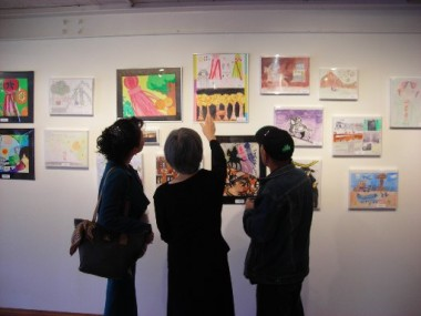 File photo of visitors viewing earlier exhibit at Riverside Community Arts Association