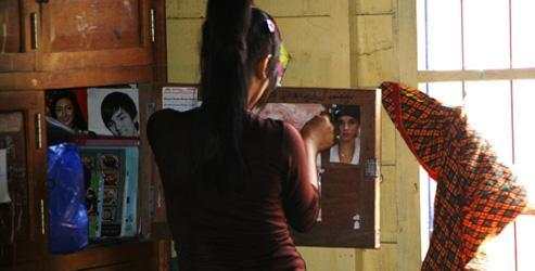 A teenage girl who is a human trafficking survivor stands in her room at a shelter managed by AFESIP Cambodia. Image: AFESIP