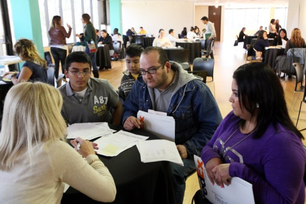 An immigrant father seeks advice on submitting an application for his son for a deportation reprieve at a legal clinic on Deferred Action for Childhood arrivals. (Ben Torres)