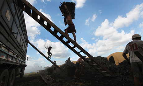 A worker carries a bag of charcoal on to a truck in Rondon do Para. Brazil was the last country to withdraw from the transatlantic slave trade. Photograph: Mario Tama/Getty